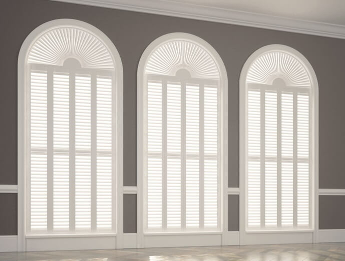white shutters on three windows