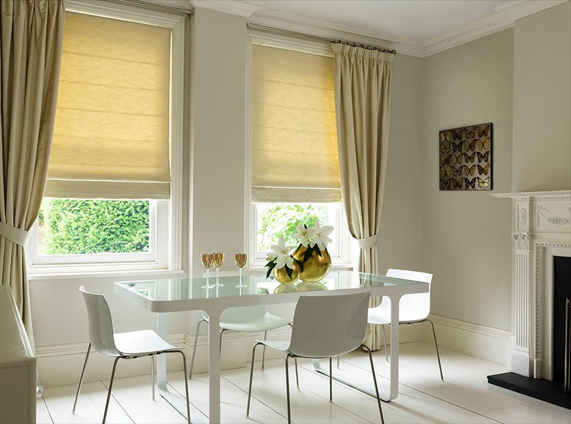 cream roman blinds in dining room