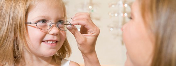 see side optical kid trying glasses