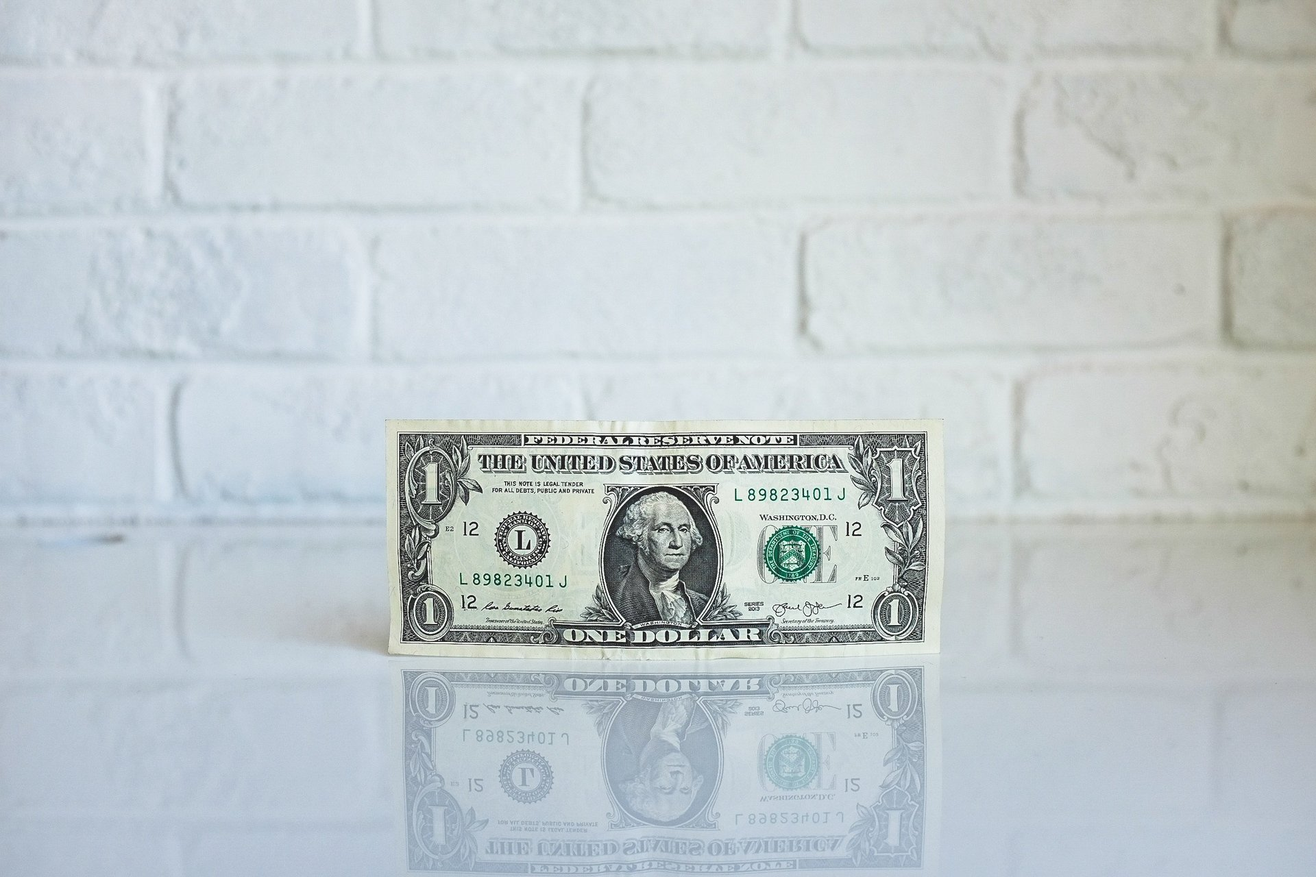 dollar bill with Washington's face imprinted on it