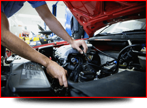 mechanic inspecting engine under the bonnet