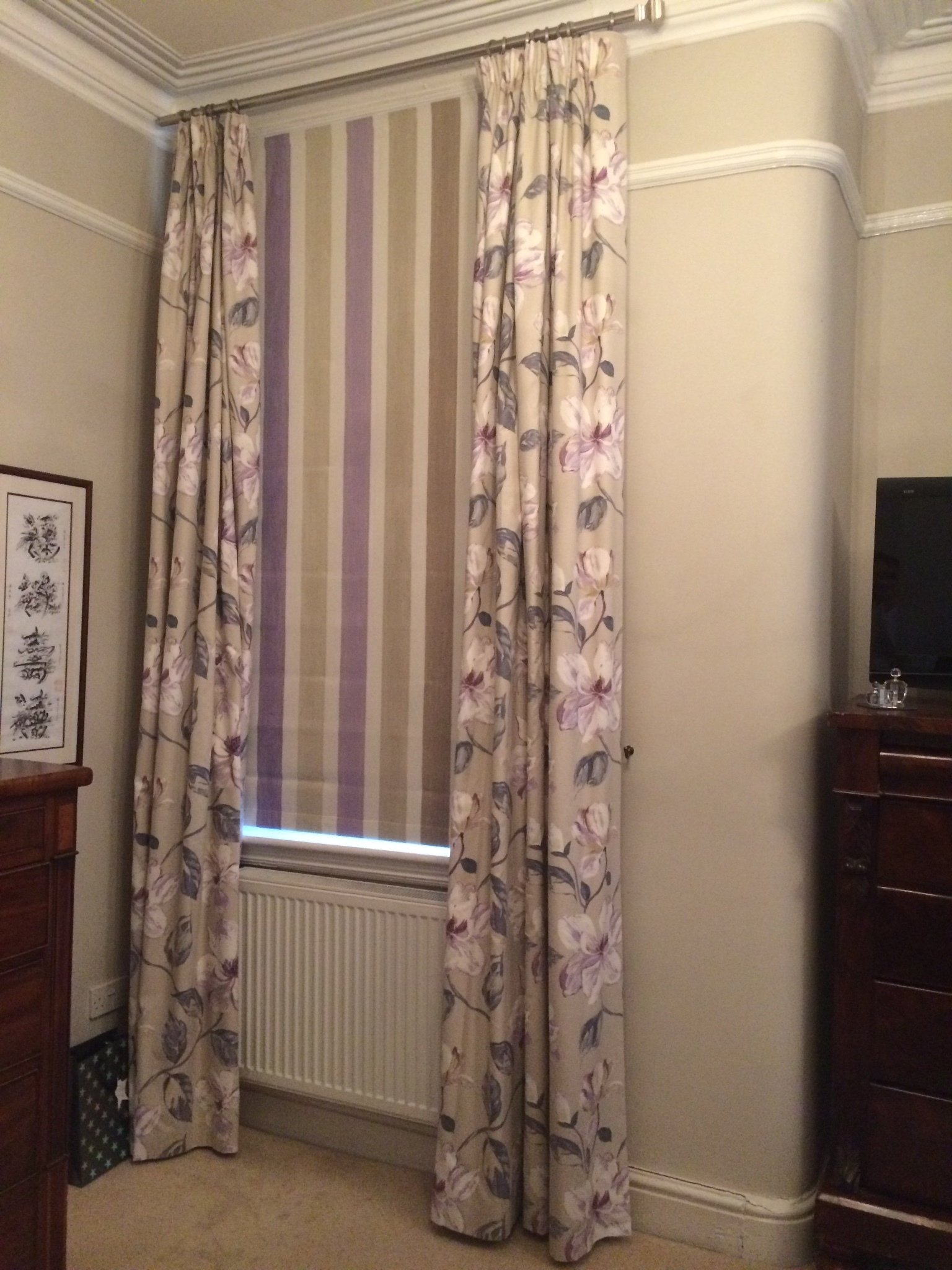 purple and cream coloured curtains