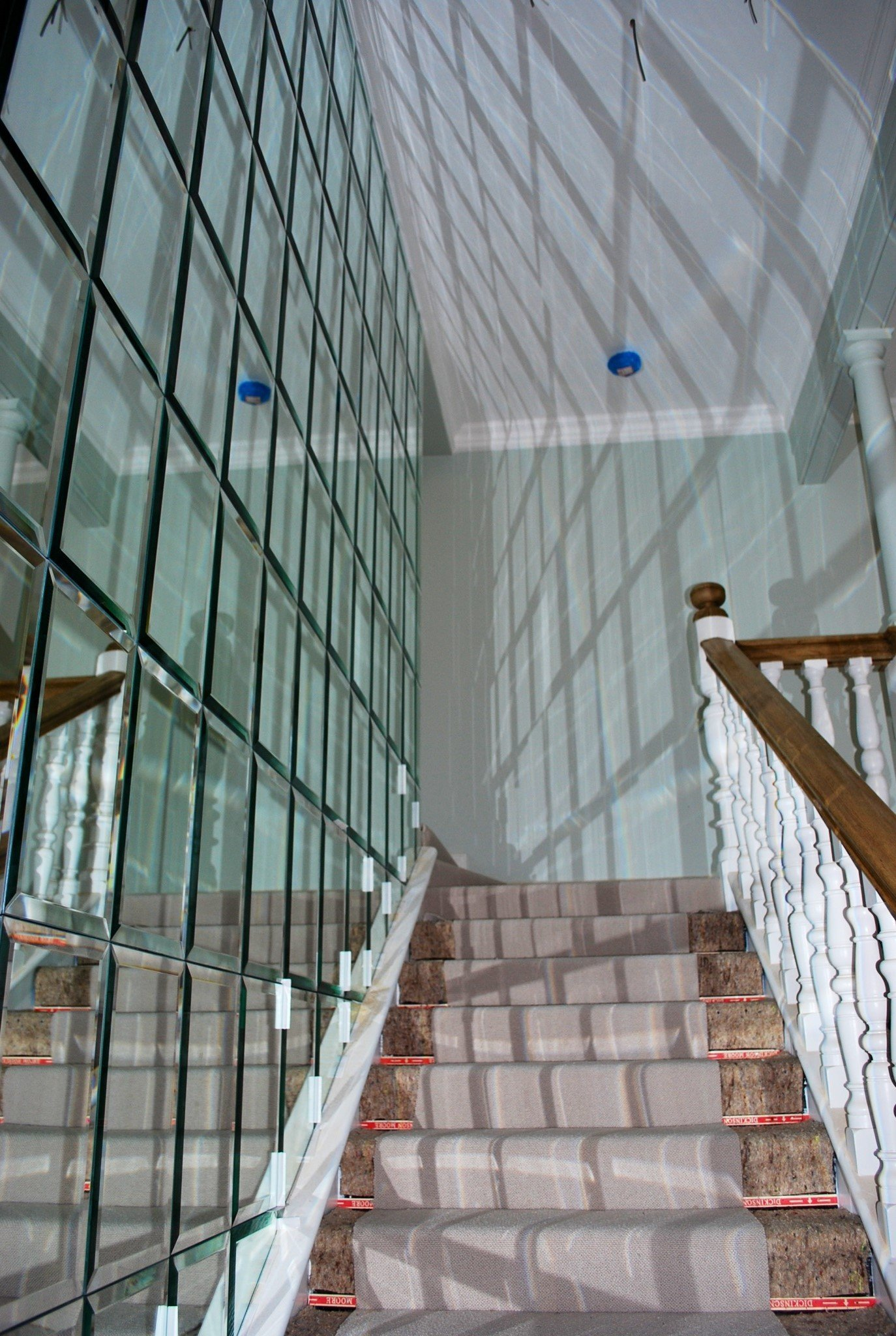 glass wall beside the staircase