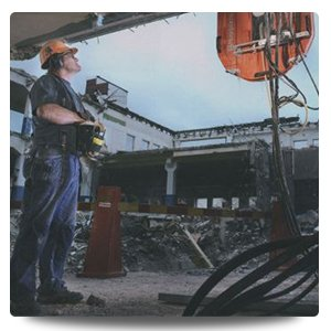newcastle cut n drill professional standing next to drill