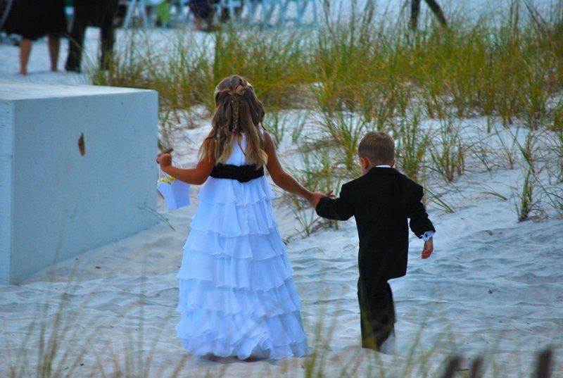 children at beach wedding