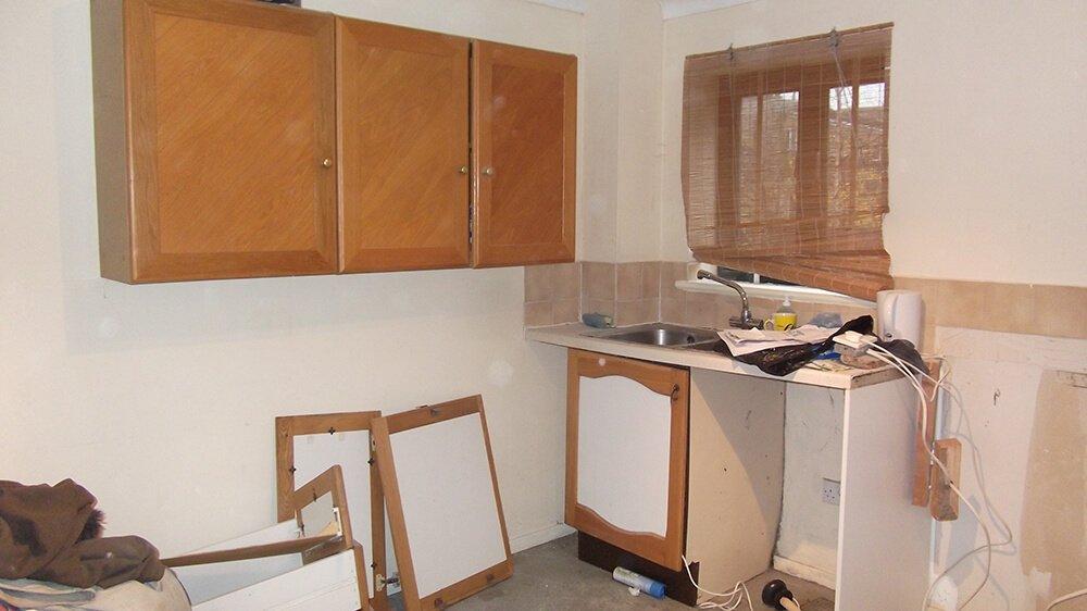 kitchen taken apart for refurbishing