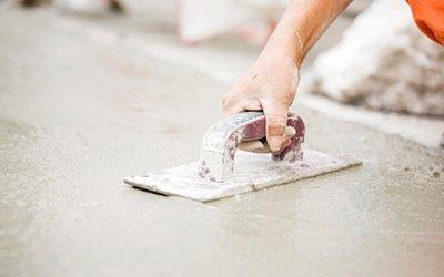 man-flattening-concrete