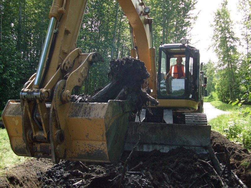 Heavy machine being used for excavation process in Anchorage