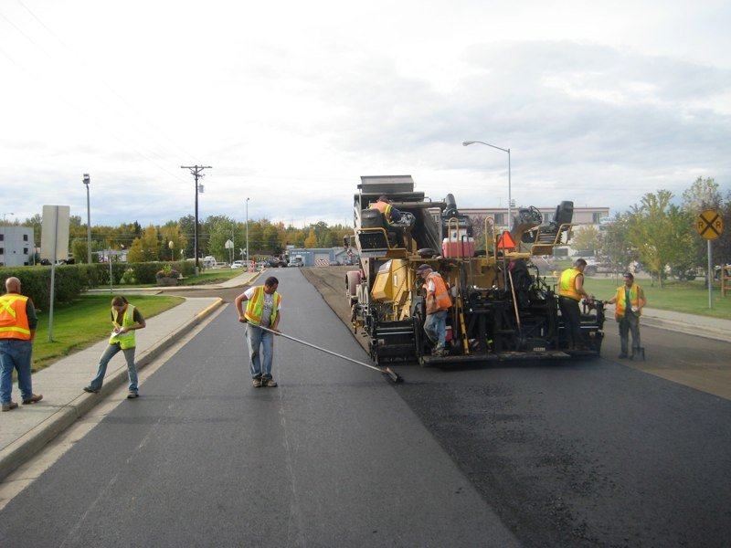 Paving of road being done by professionals in Anchorage