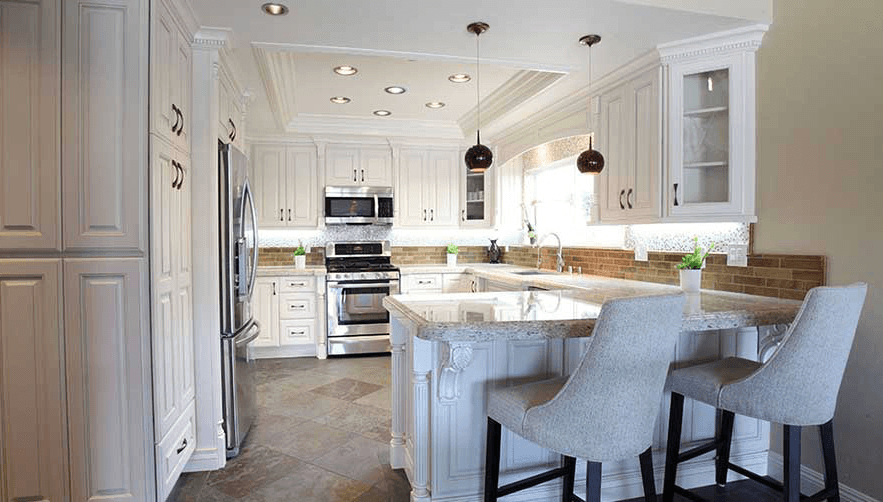 traditional kitchen with white cabinets & granite countertops