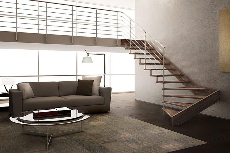 vista di un salotto moderno con un divano, un tavolino e delle scale