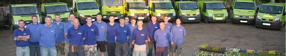 Evergreen Landscape team in front of vehicles