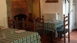 sala con camino, gastronomia lombarda, osteria