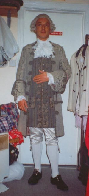 A man in Tudor style costume and white wig