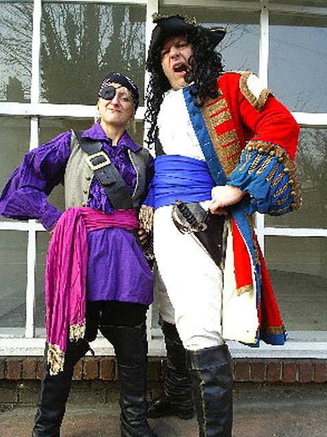 Man and woman in pirate costumes