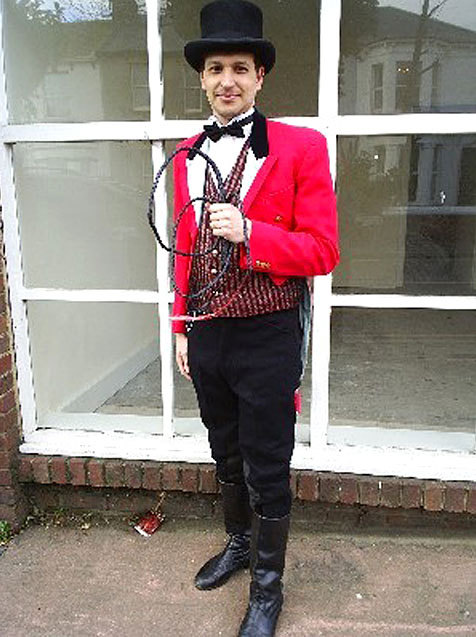 A man dressed as a ringmaster