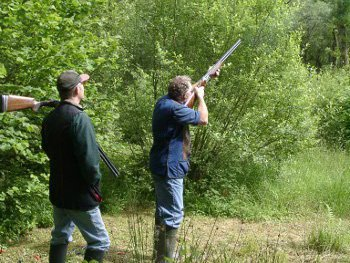 a man aiming