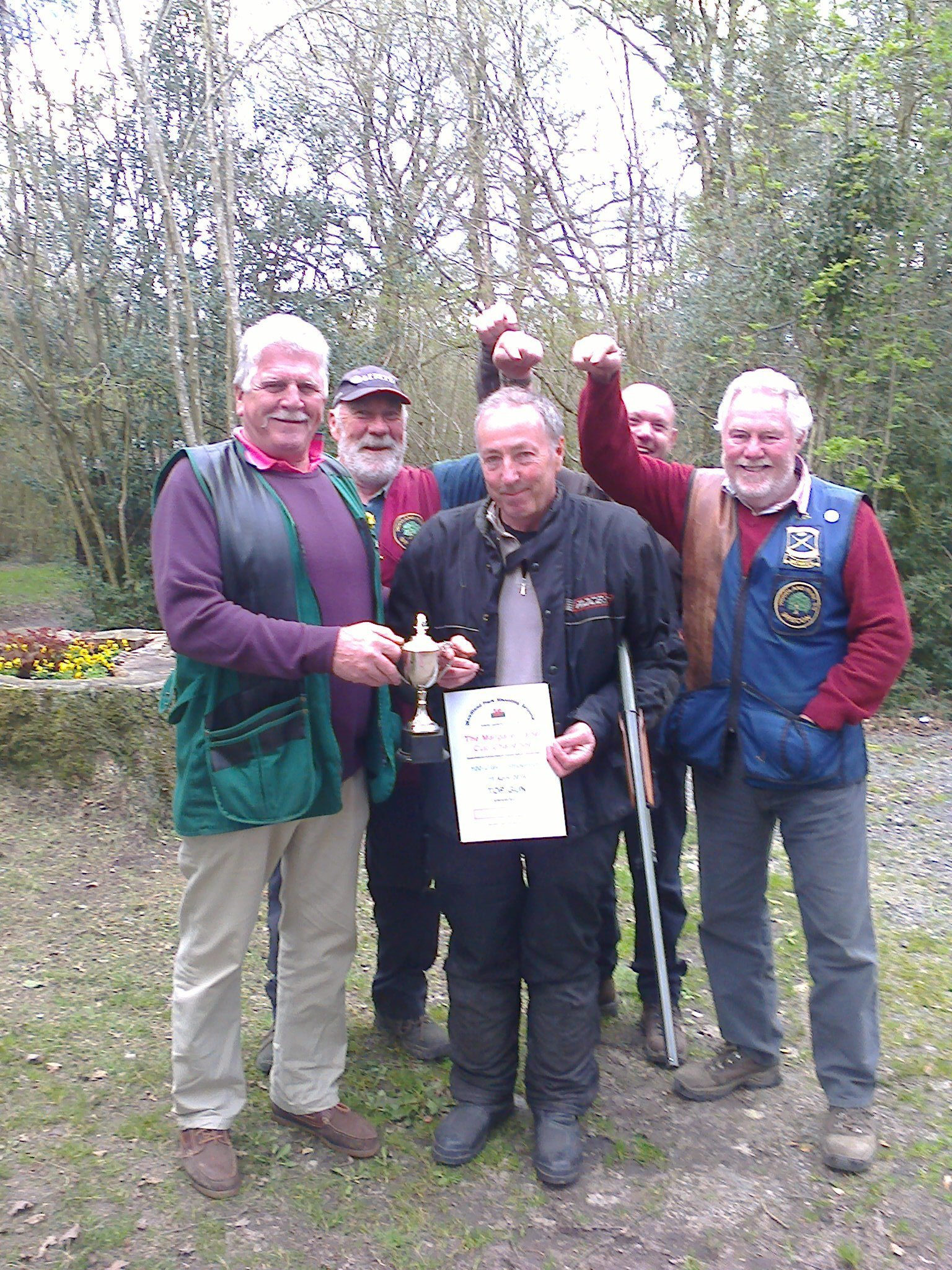 several men holding the certificate