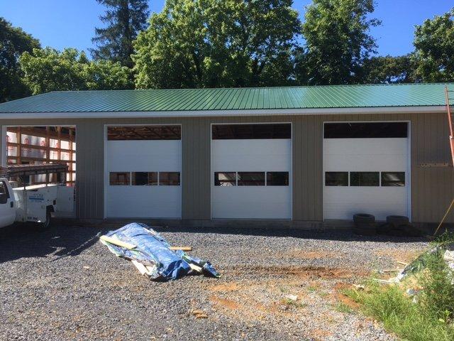 Construction Siding Added Garage Doors
