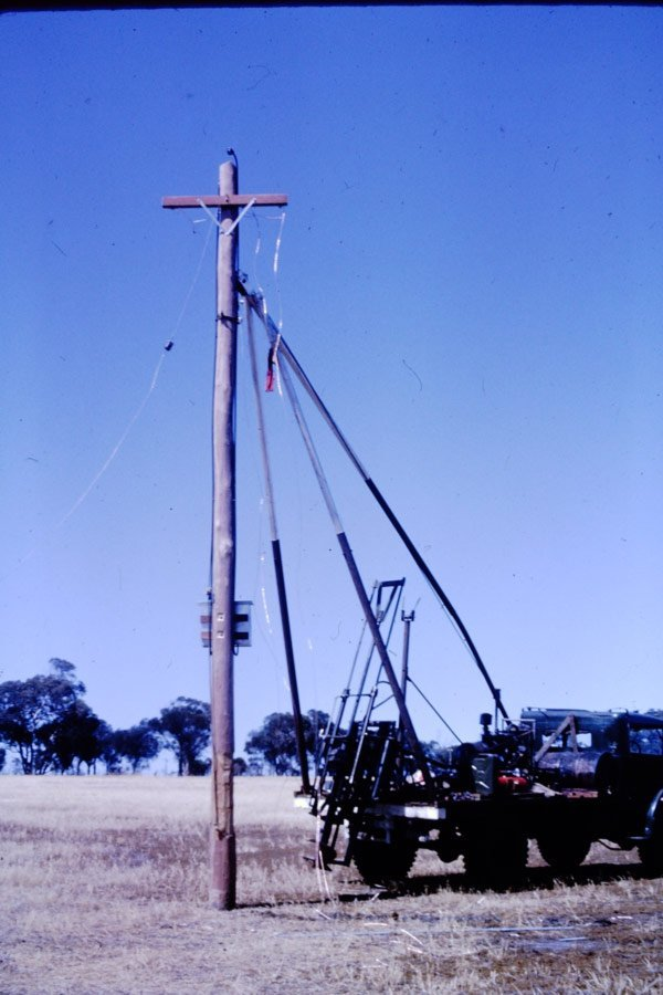 crane standing electrical pole