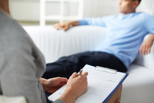 woman counselor with male patient