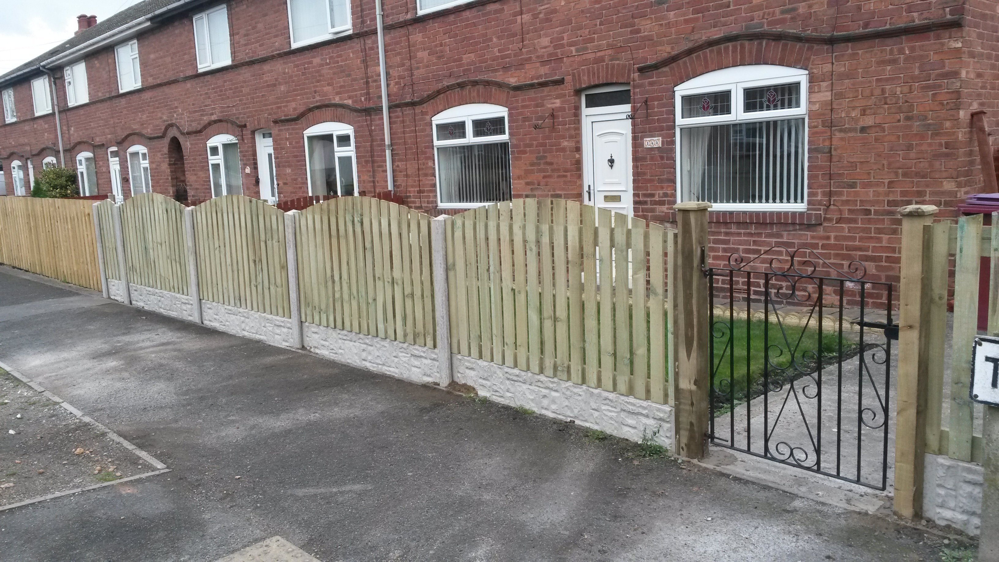 Tember fence with concrete posts