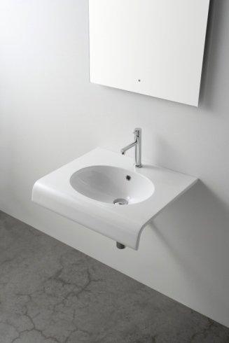 un lavandino di color bianco che assomiglia a una mensola
