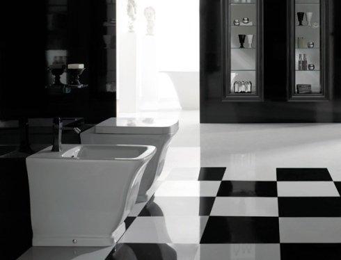 un wc e un bidet di color bianco e delle piastrelle di color bianco e nero