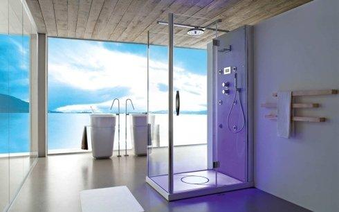 un bagno con un box doccia con dentro luci a led e vista di un lago