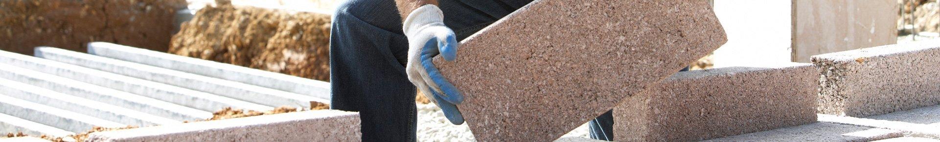 contractor laying masonry blocks