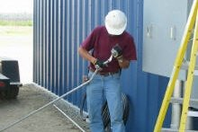 electrician preparing a tool to use for maintenance work
