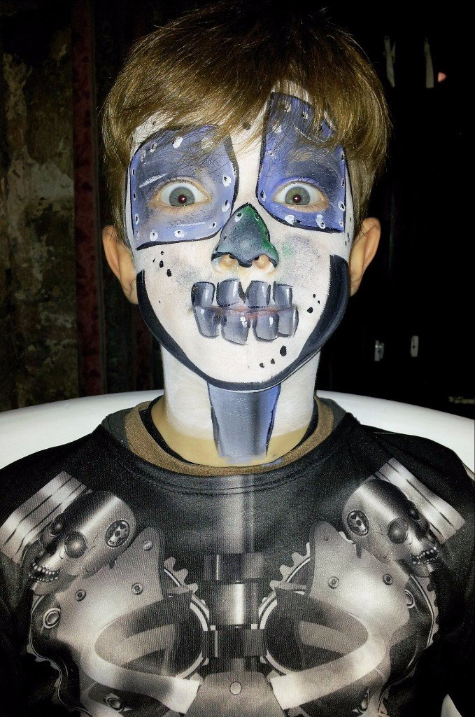 kid face painted like a skeleton
