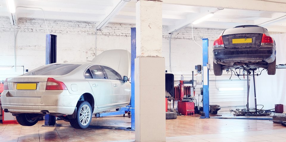 two cars at the MOT