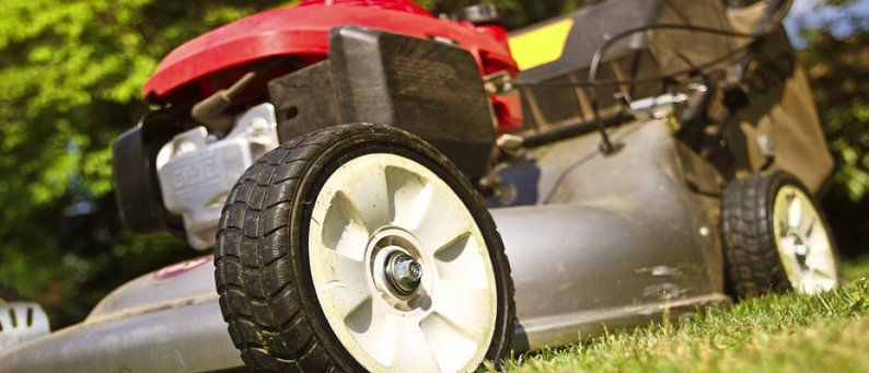 Close view of a red ride-on mower