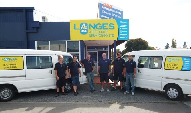 Front view of Lange's A1 Appliance Servicing Ltd with vehicles and professionals