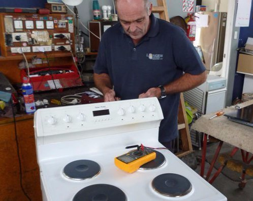 Experienced professional repairing electronic equipment