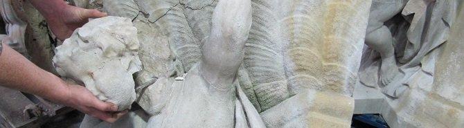 A craftsman holding a cherub's head