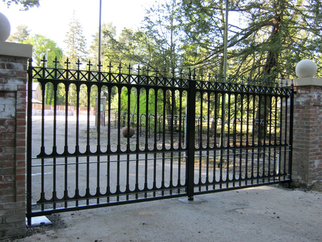 Wrought iron sliding gates leading to a private driveway