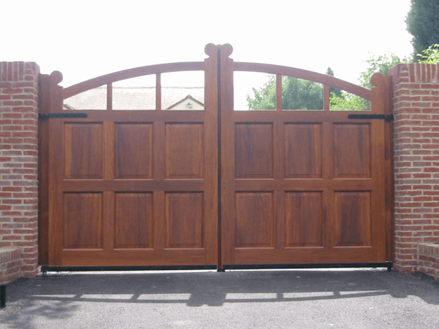 Custom wooden driveway gates with arch at the top