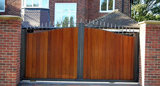 Hardwood driveway gates with metal frame