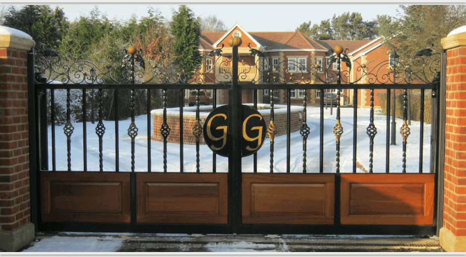 Custom automatic gate leading to mansion house driveway
