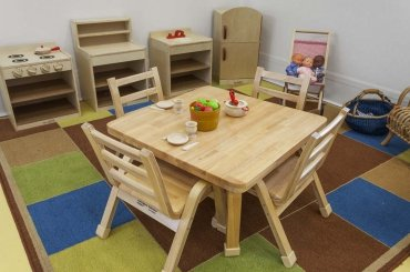 My Cubby House Child Care Centres Gold Coast Activity Facility Brown Table and Chair with Sitting Baby Toys