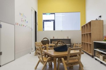 My Cubby House Child Care Southport Activity Facility Brown Chair and Table with White Wall