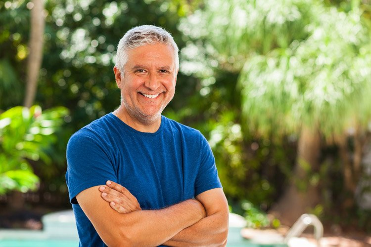 smiling man outdoors by pool