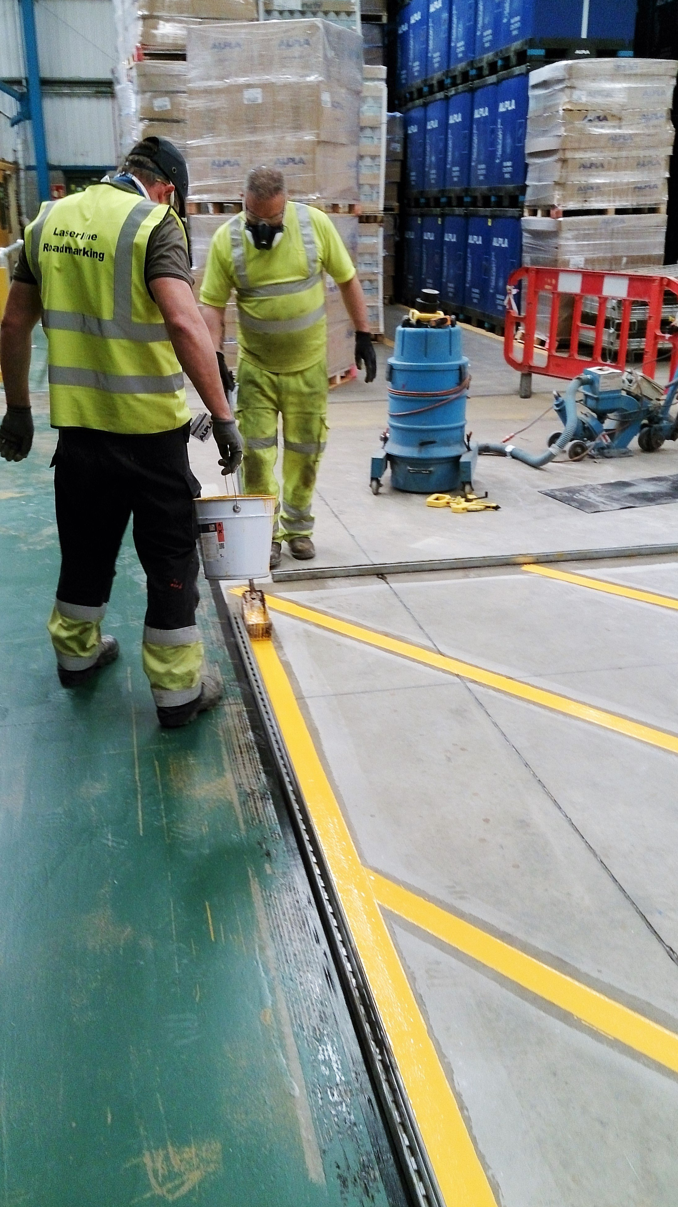 workers painting lines