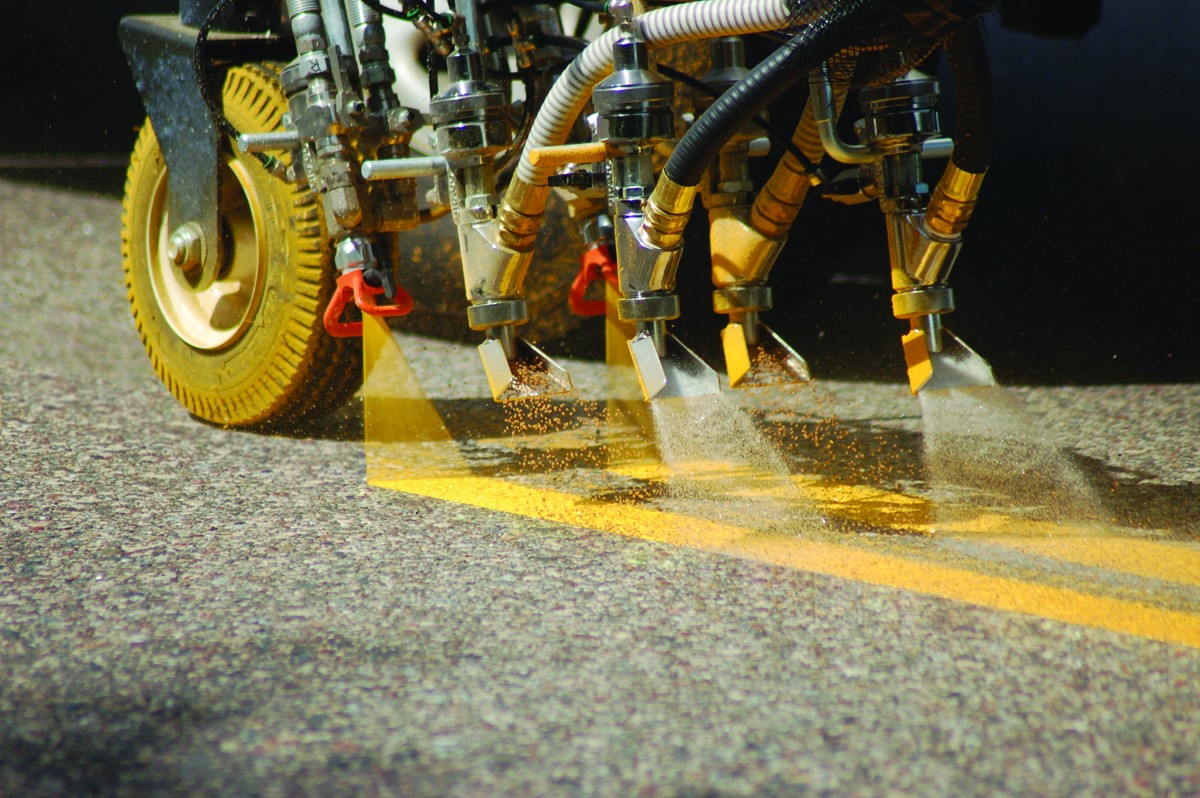 yellow lines being sprayed
