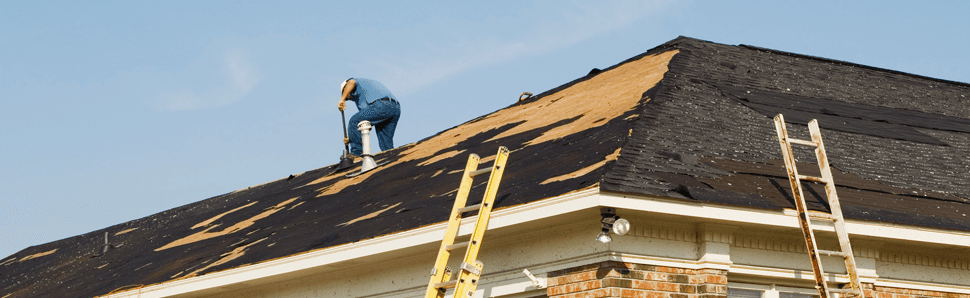 Roof repairs being carried out by a roofer