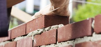 Bricks being laid in a wall