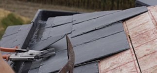 Roof tiles being applied to a roof