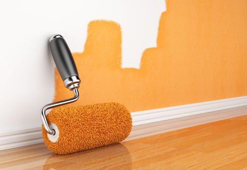 Orange paint on the wall done with roller brush in Grantham, NG